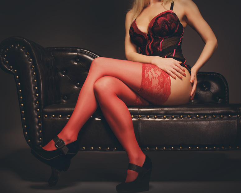 BFotolia_8898187Beautiful slim legs in black nylons on a red backgroundFotolia_88981879