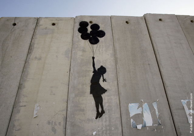 Banksy street art on the Security Wall, Israel/Palestine
