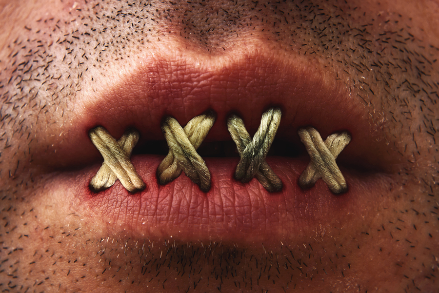 Close up of mans mouth with lips stitched or sewn shut bigstock-Sewn-Mouth-35966338.jpg