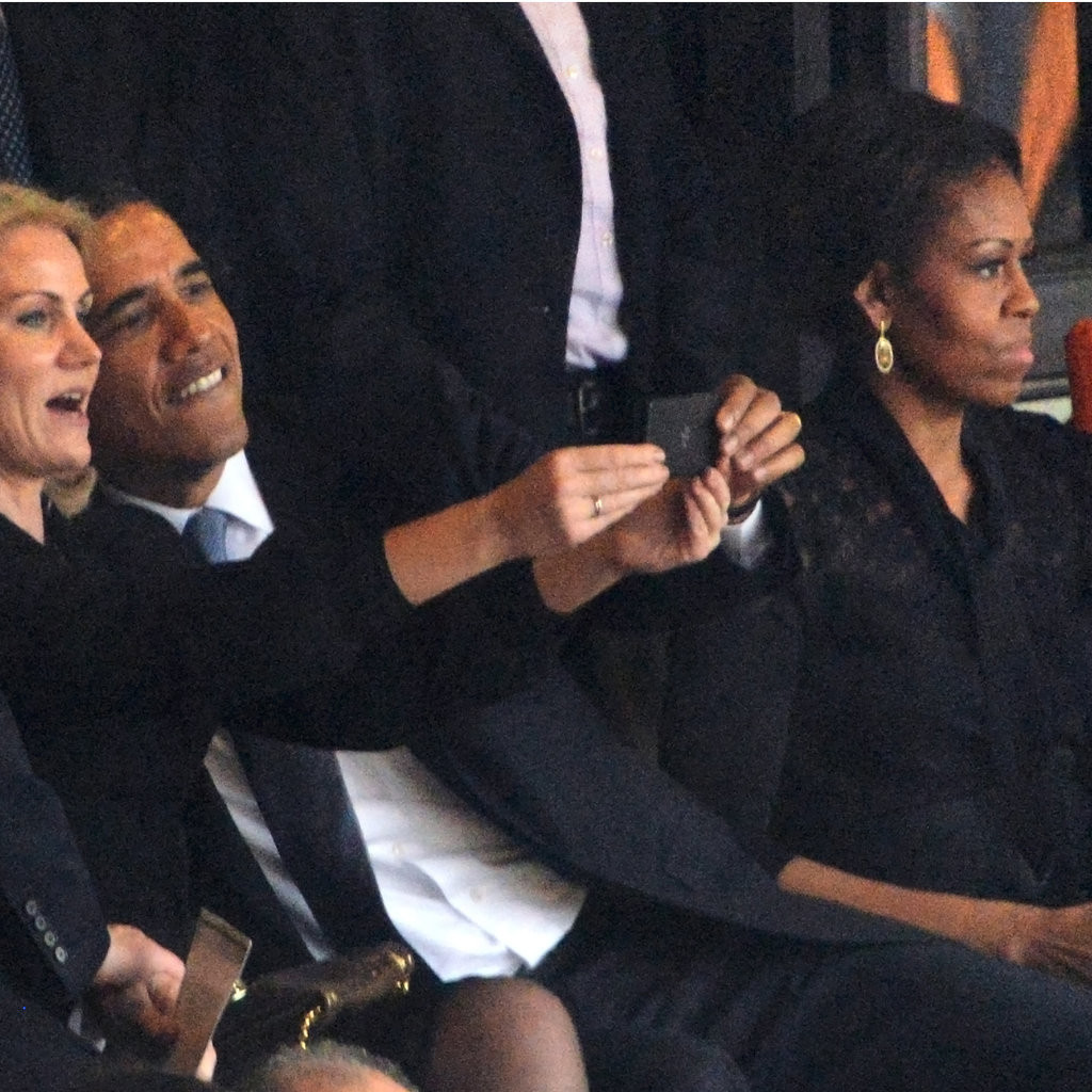 Michelle Obama looks away as (L-R) British Prime Minister David Cameron, Danish Prime Minister Helle Thorning-Schmidt and US President Barack Obama take a selfie Photo: ROBERTO SCHMIDT/AFP