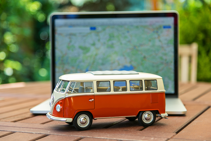 PRAGUE, CZECH REPUBLIC - JULY 10, 2015: Miniature VW Bulli 1962 on laptop. The cult car of the Hippie generation and it remained the status vehicle of the high wave surfers. Stock Photo ID: 96356084 Copyright: Kesu01