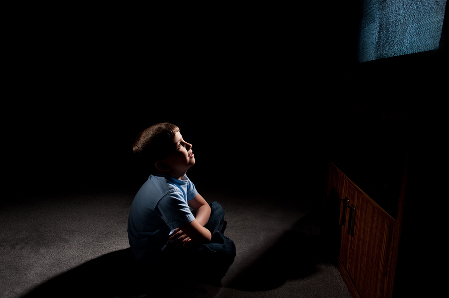 bigstock-4681011 Six year old boy watching static on television in the dark