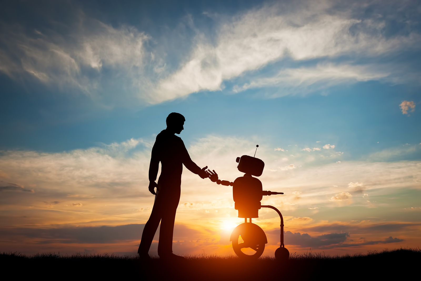 Source : Bigstock 127357220. Man and robot meet and handshake. Concept of the future interaction with artificial intelligence. 3D rendering.