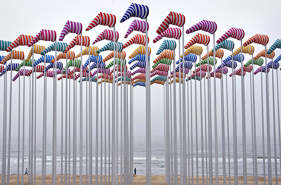 A creation made with wind cones and designed by French conceptual artist Daniel Buren is seen as a part of Beaufort 03 Contemporary Art by the Sea exhibition in De Haan April 21, 2009. REUTERS/Thierry Roge   (BELGIUM ENTERTAINMENT SOCIETY IMAGE OF THE DAY TOP PICTURE)